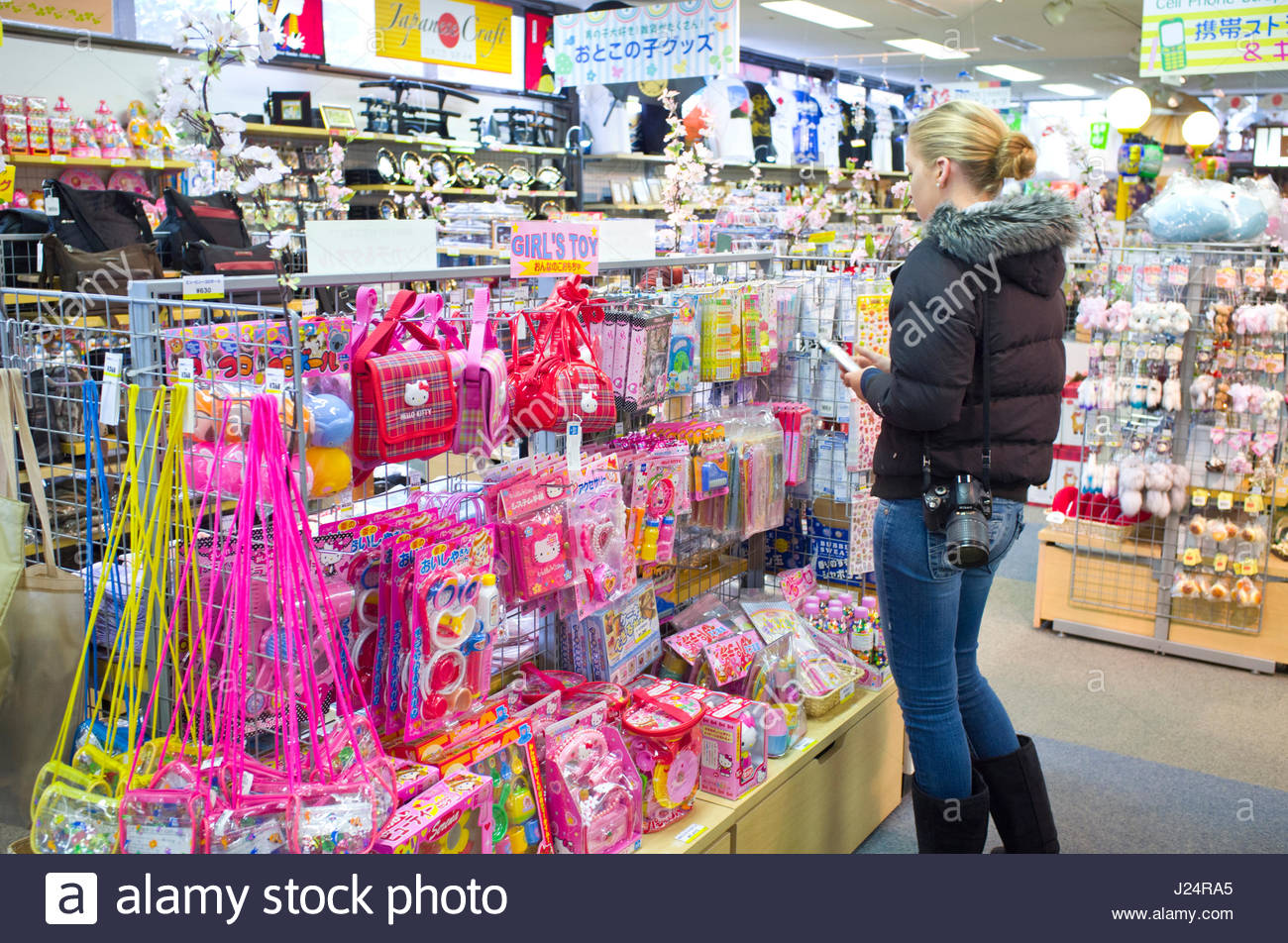 caucasian teenage girl shopping for cute gifts for her friends motohakone hakone machi kanagawa kanto honshu japan