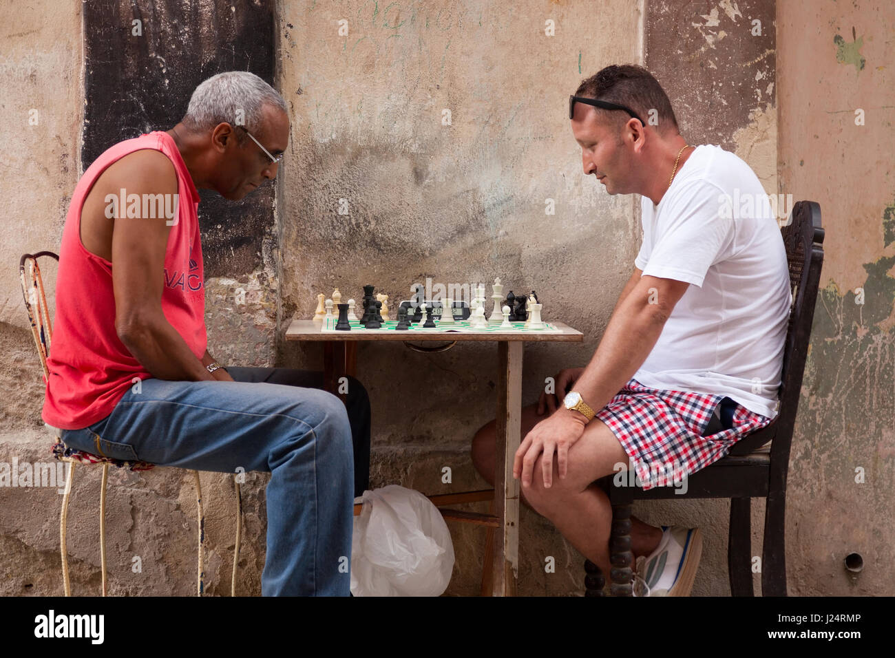 Two Cuban men playing chess in the street in Havana, Cuba. - Stock Image