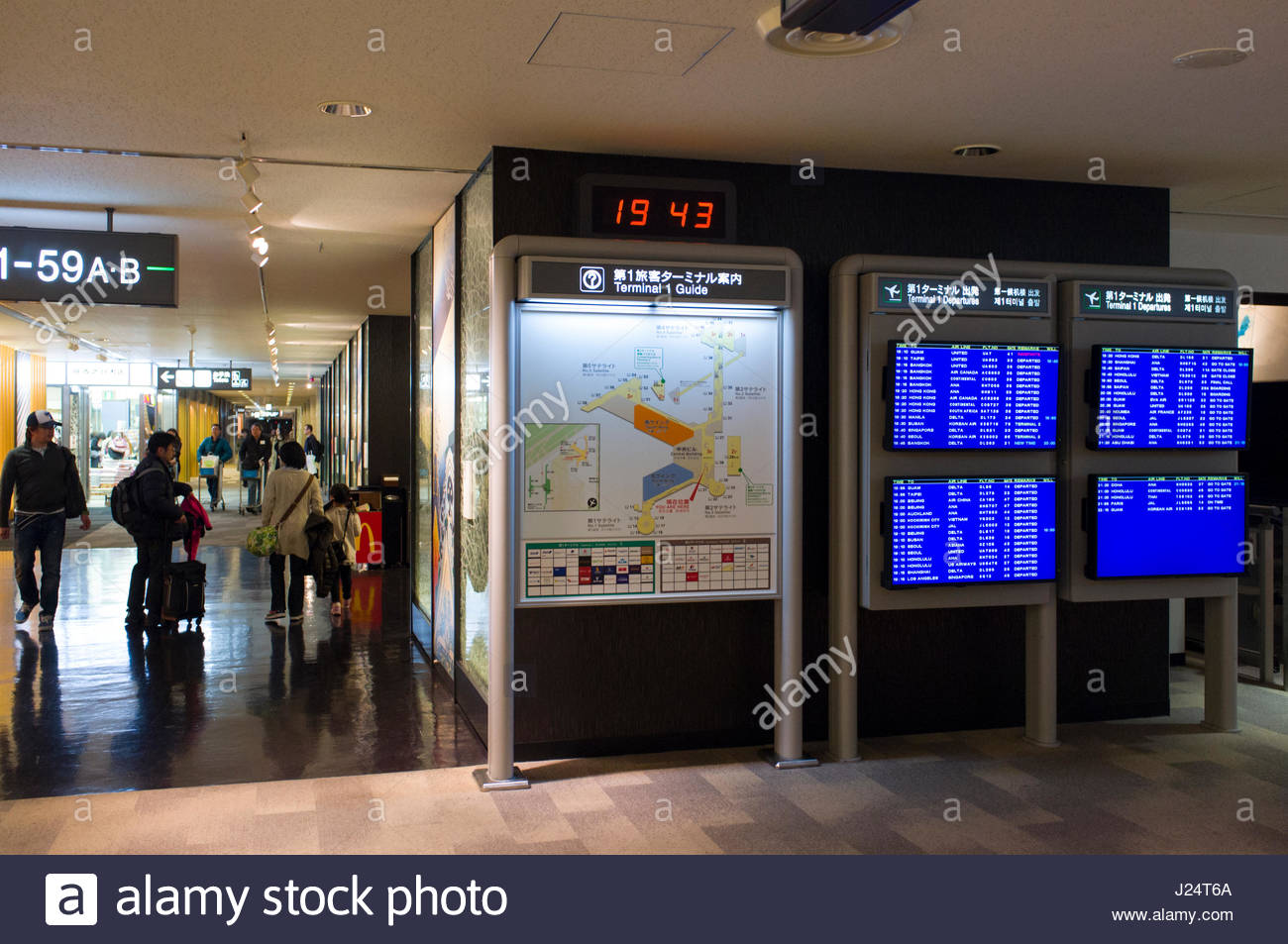 Monitors with flight information, Narita International Airport, NRT, Narita-shi, Chiba, Honshu, Japan - Stock Image