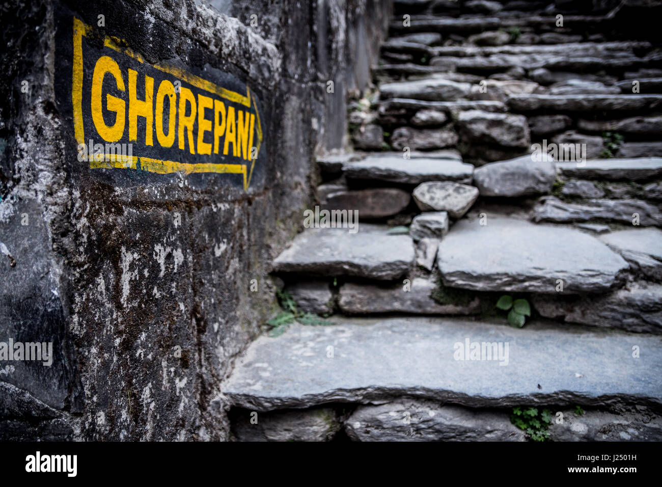 Nepal, March 2017: A sign indicates the way to Ghorepani at Birethanthi, the start of the Annapurna circuit trek - Stock Image