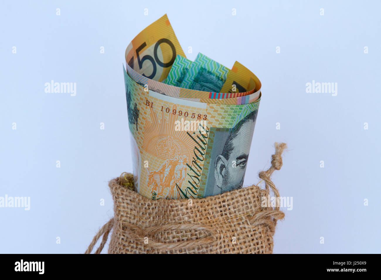 Australian dollars in a hessian bag. - Stock Image