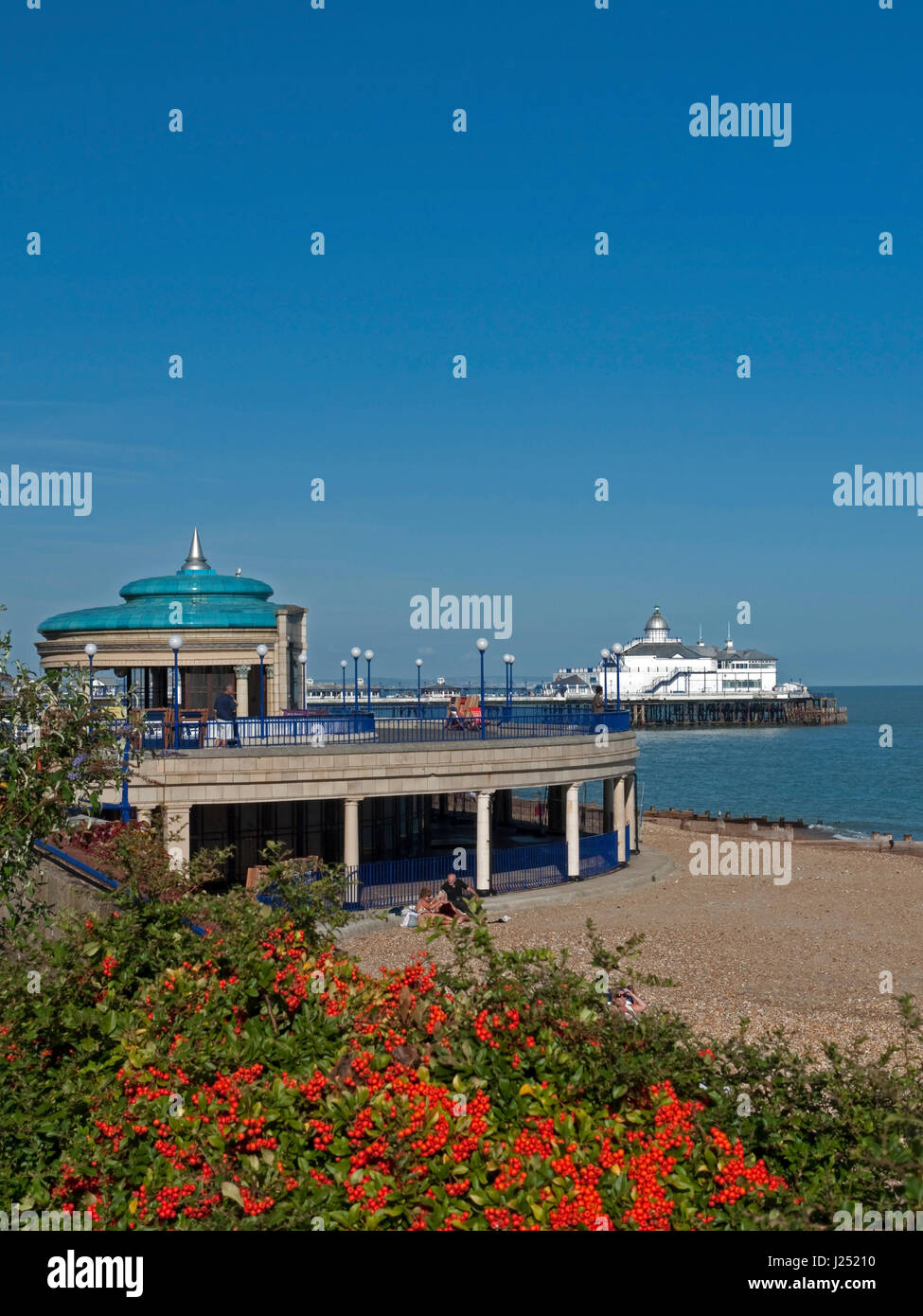 The Colourful Eastbourne Seafront with its iconic Bandstand and Pier, Eastbourne, East Sussex, England, UK - Stock Image