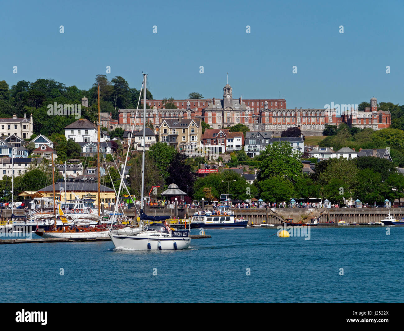 The busy River Dart with Dartmouth and its Naval College beyond, viewed from Kingswear, Devon, England, UK Stock Photo