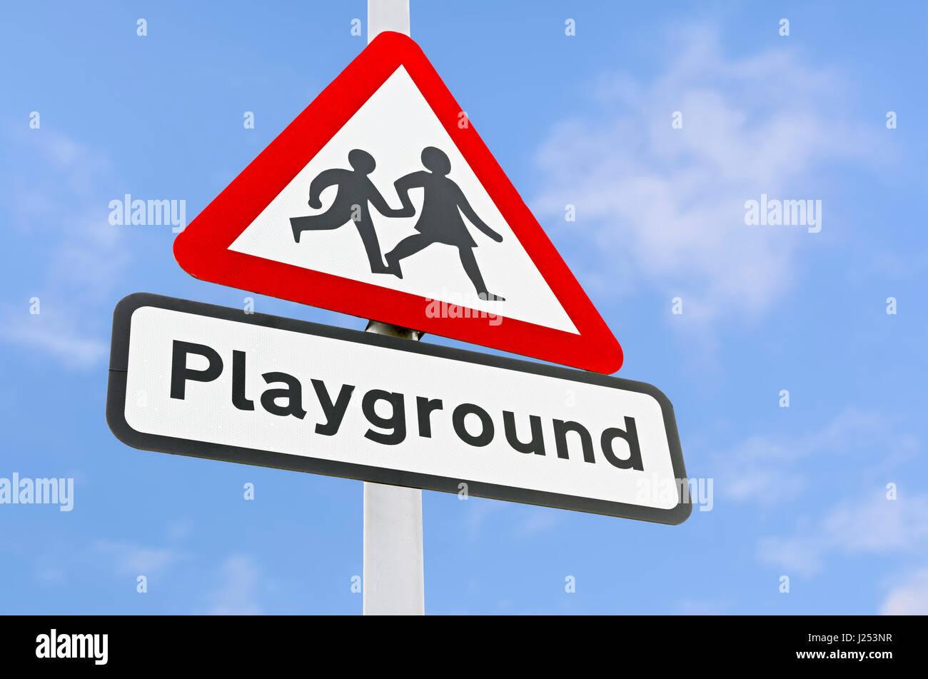 Triangular playground warning sign. Stock Photo