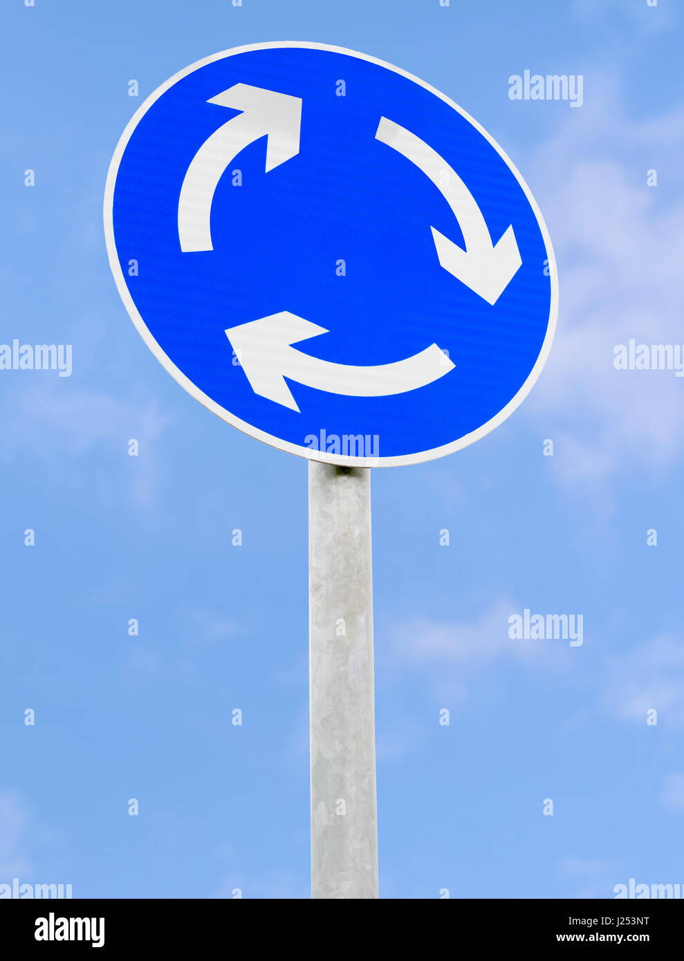 Mini roundabout road sign in the UK. - Stock Image