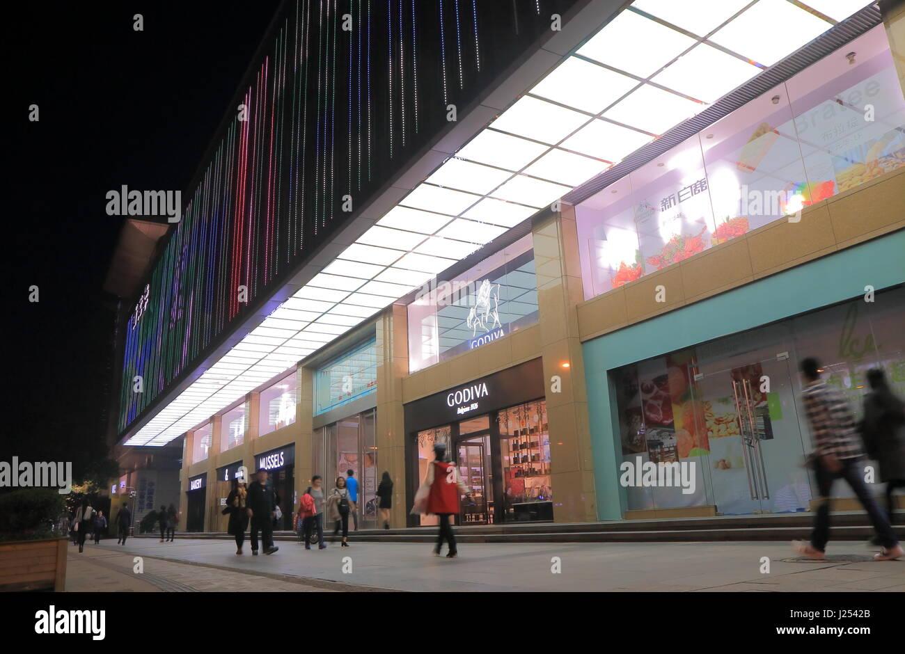 d62da925d211e8 People visit Baixin Yuan China Shopping Mall in Hangzhou China. Baixin Yuan China  Shopping Mall