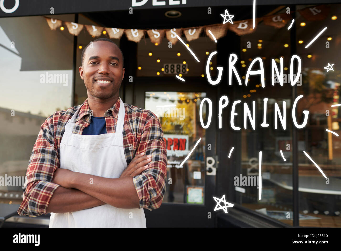 black male business owner outside coffee shop grand opening stock
