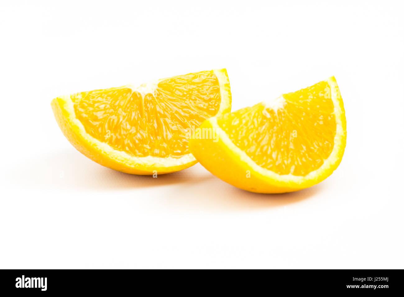 Two fresh orange slices  isolated on white background. Two Objects. Orange Slices. - Stock Image