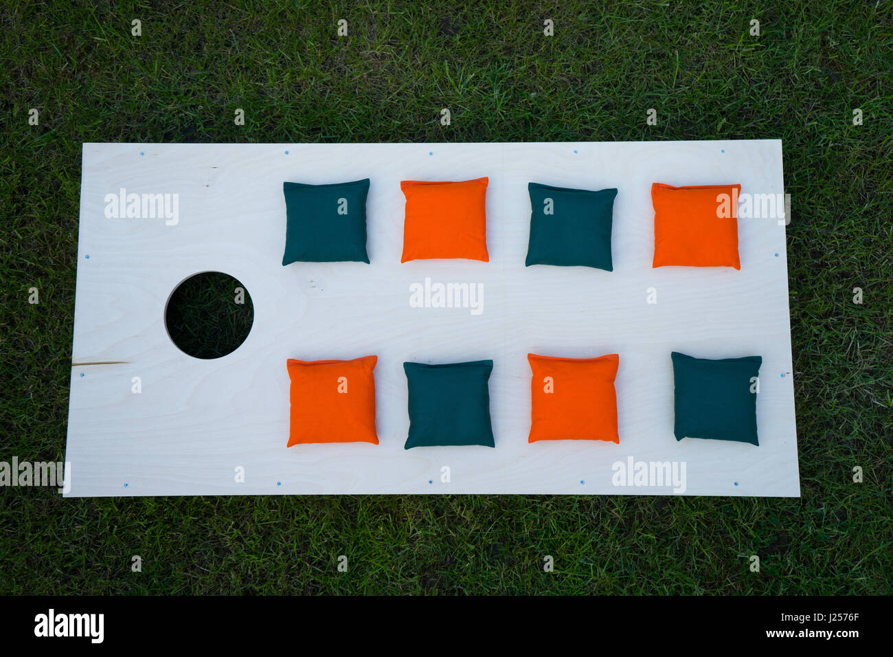 Cornhole Board Flat Lay with beanbags on grass - Stock Image