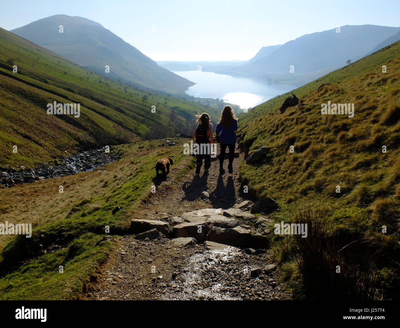 People hiking up to Scafell Pike in the Lade District, Cumbria, England's highest mountain. - Stock Image
