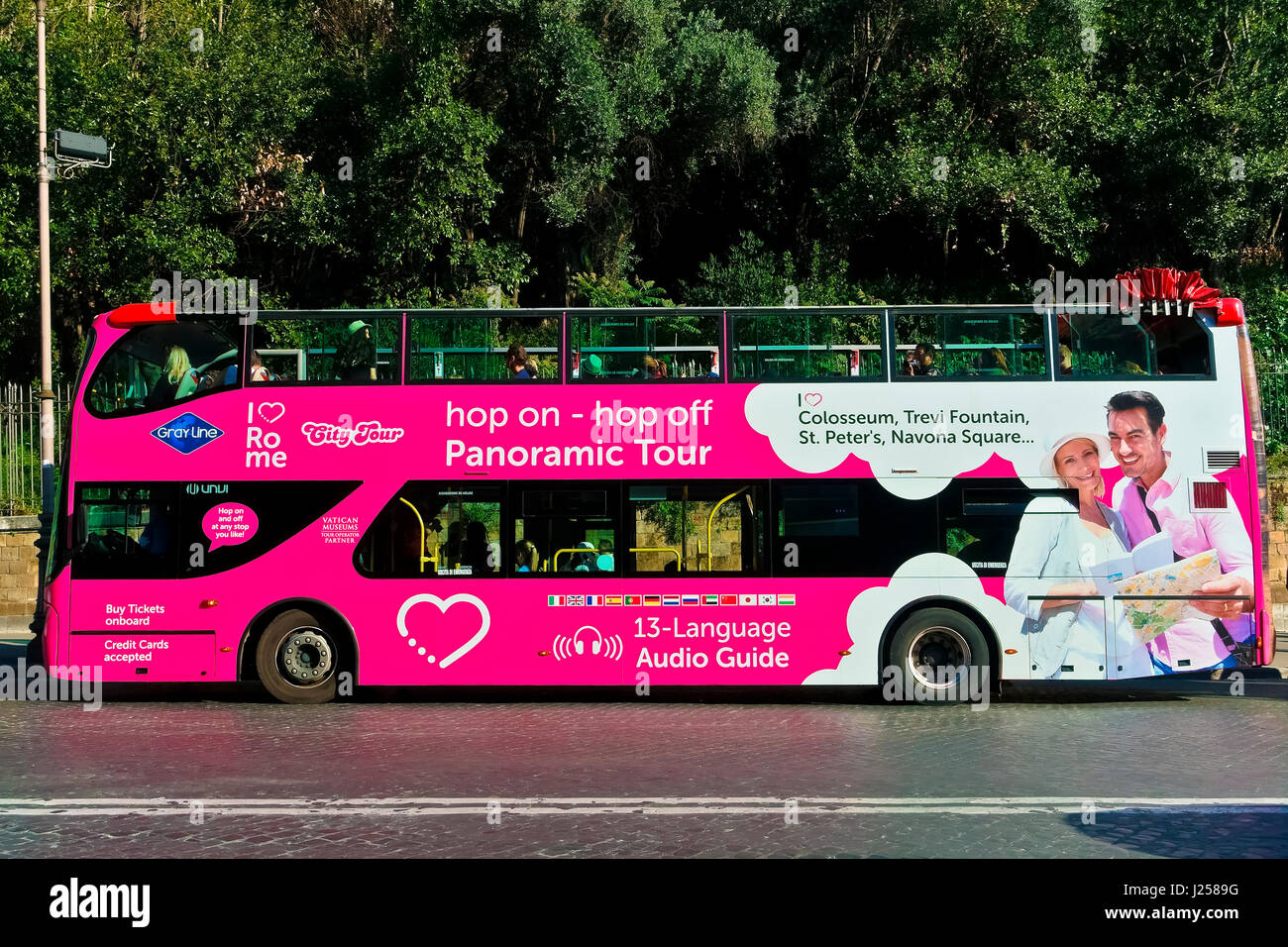 Pink sightseeing double decker open bus, tourism. Hop on hop off. Rome, Italy, Europe - Stock Image
