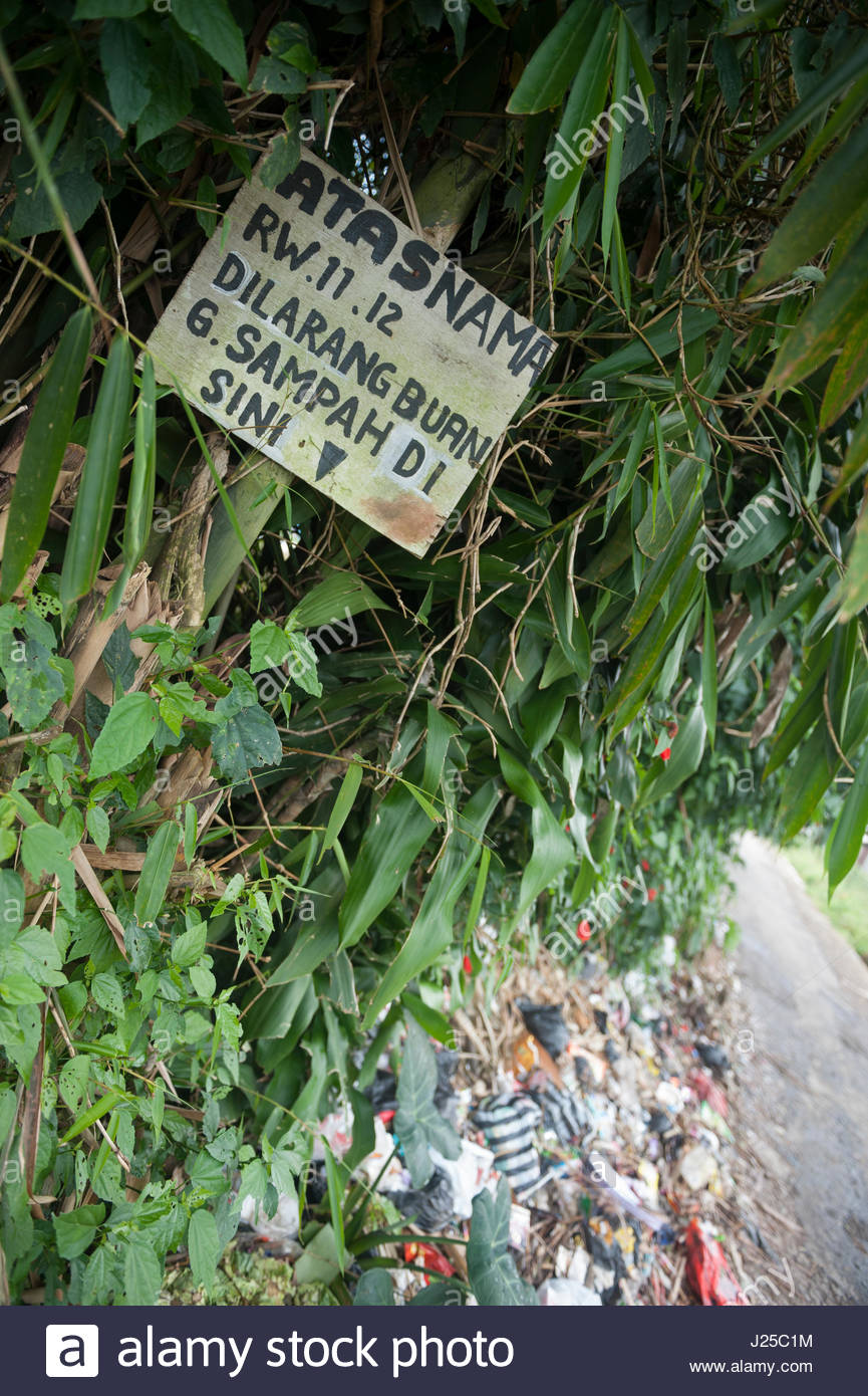 Cianjar Indonesia A sign requests people not to throw their litter in the verge. A request much ignored. Single - Stock Image