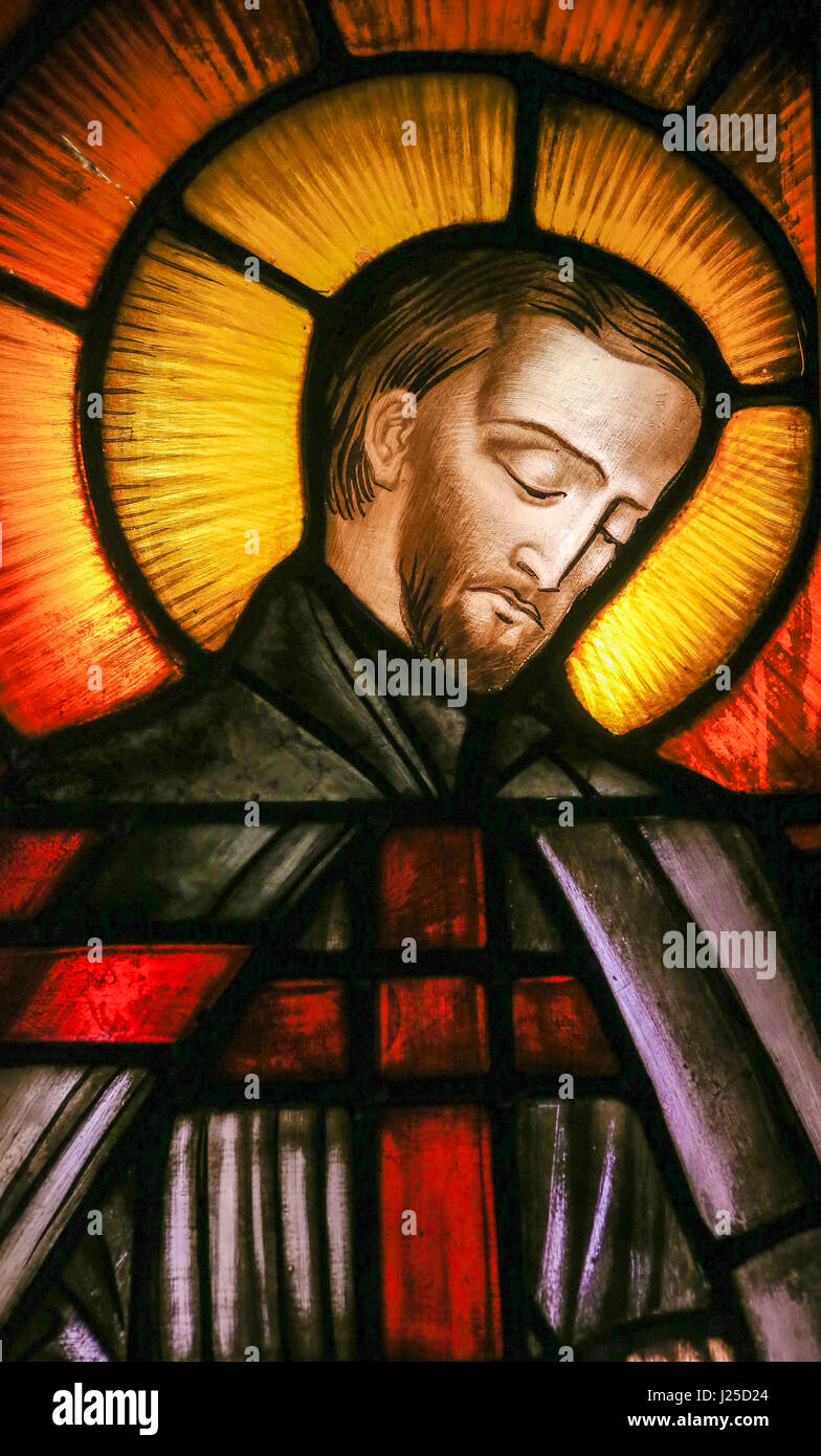 Stained Glass window in the 15th Century Elzenveld Chapel in Antwerp, Belgium, depicting Father Damien or Saint - Stock Image