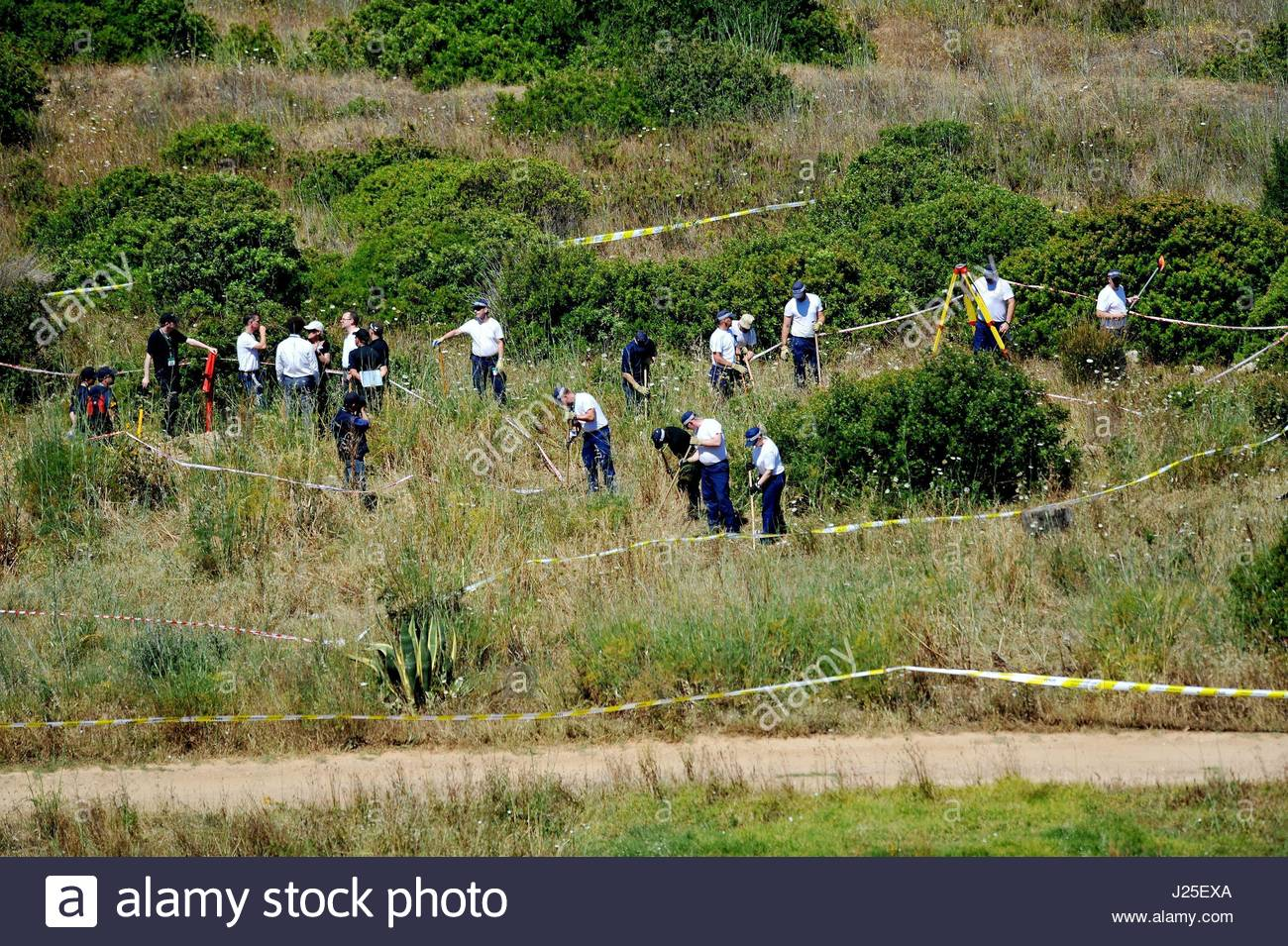 File photo dated 11/06/14 of British police and their Portuguese counterparts investigating the disappearance of - Stock Image