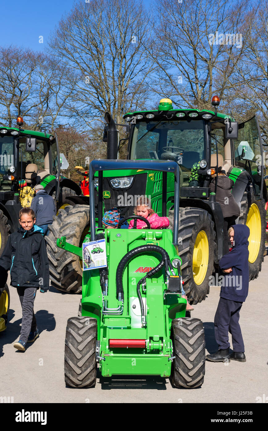 Brakne Hoby, Sweden - April 22, 2017: Documentary of small public farmers day. Families attending the John Deere - Stock Image