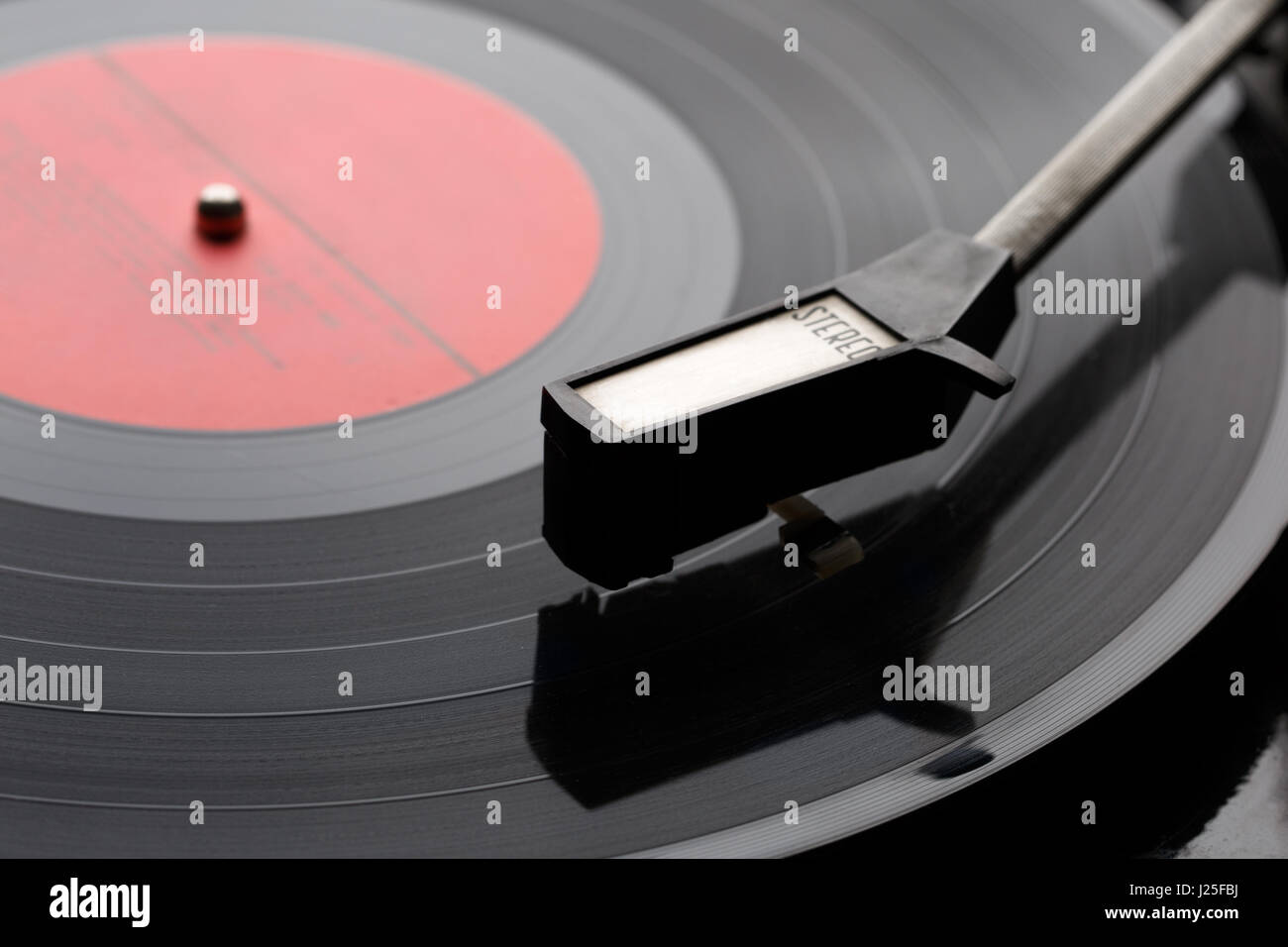 Black vinyl plate with player Stock Photo