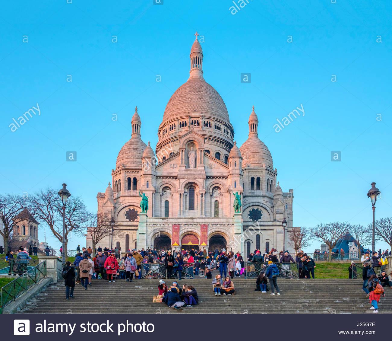 France, Île-de-France, Paris. Basilica of Sacre Coeur at sunset, Montmartre. - Stock Image