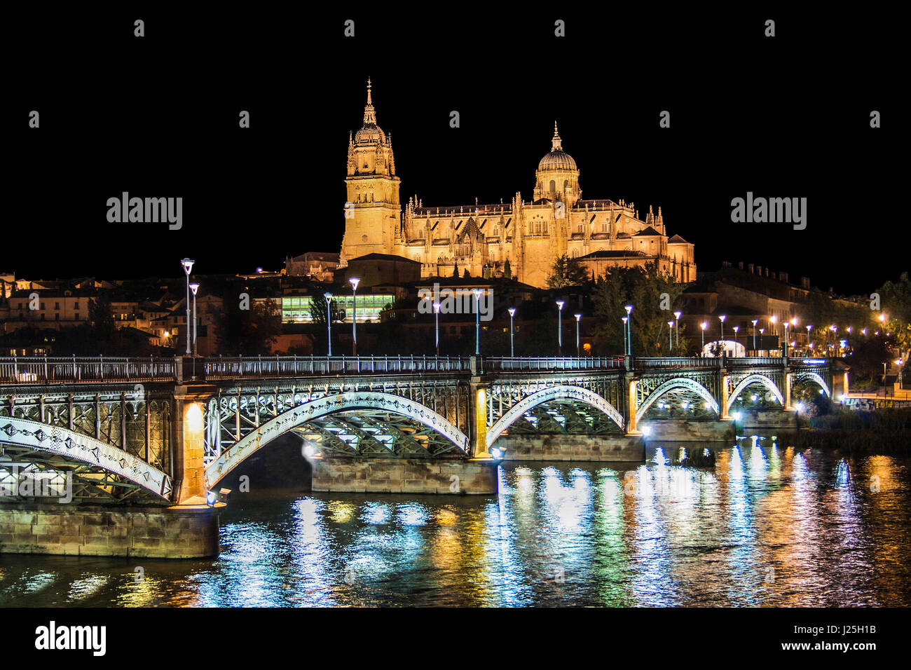 Beautiful view of the historic city of Salamanca with New Cathedral and Enrique Esteban bridge at night, Castilla - Stock Image