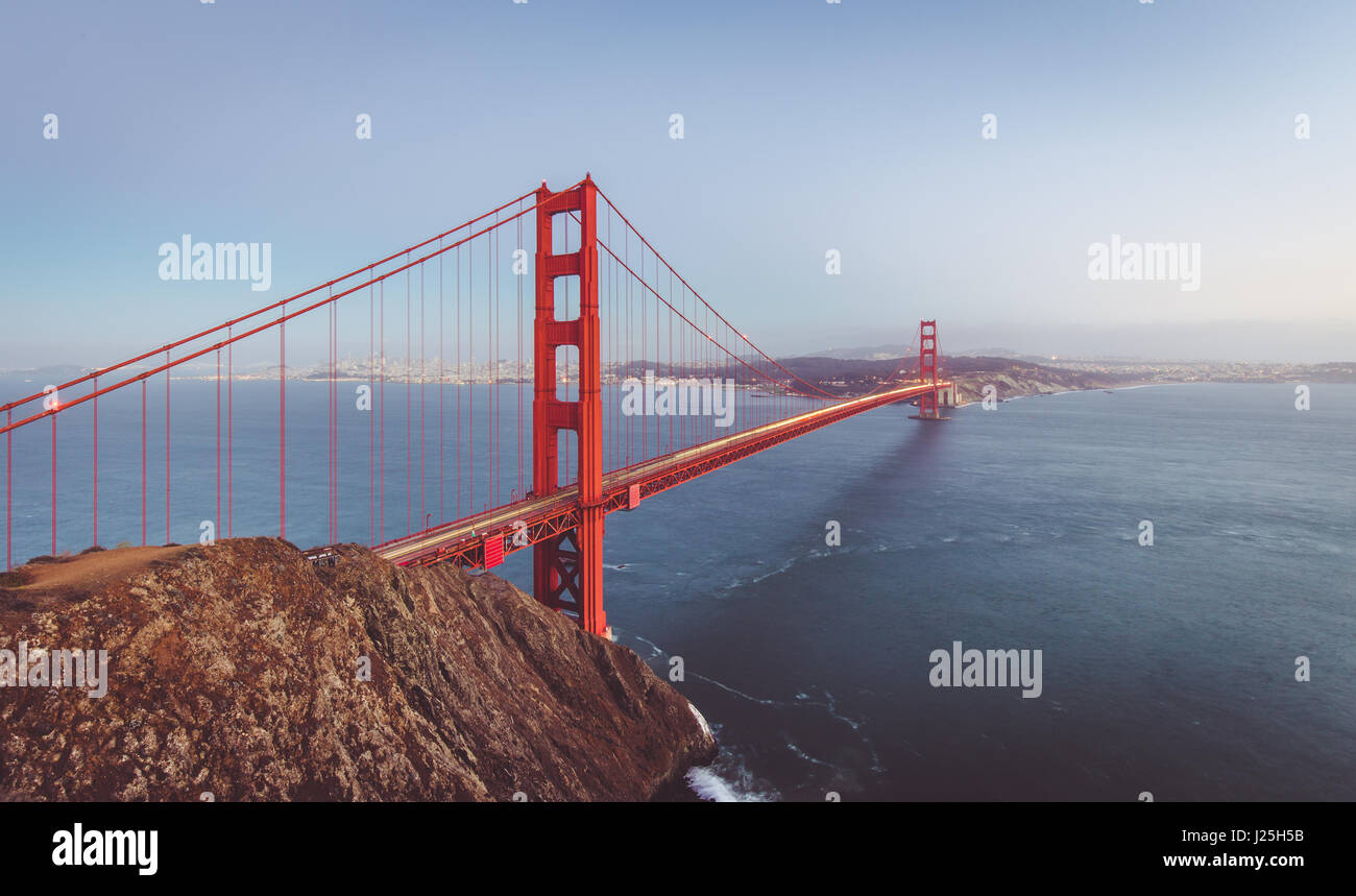 Classic panoramic view of famous Golden Gate Bridge seen from Battery Spencer viewpoint in beautiful post sunset - Stock Image