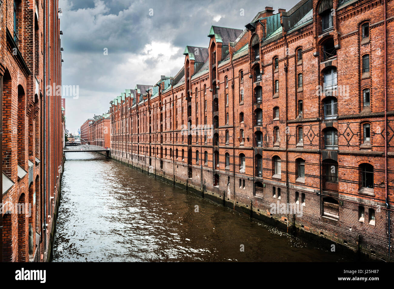 Panoramic view of famous Speicherstadt with dark clouds before the storm in Hamburg, Germany Stock Photo