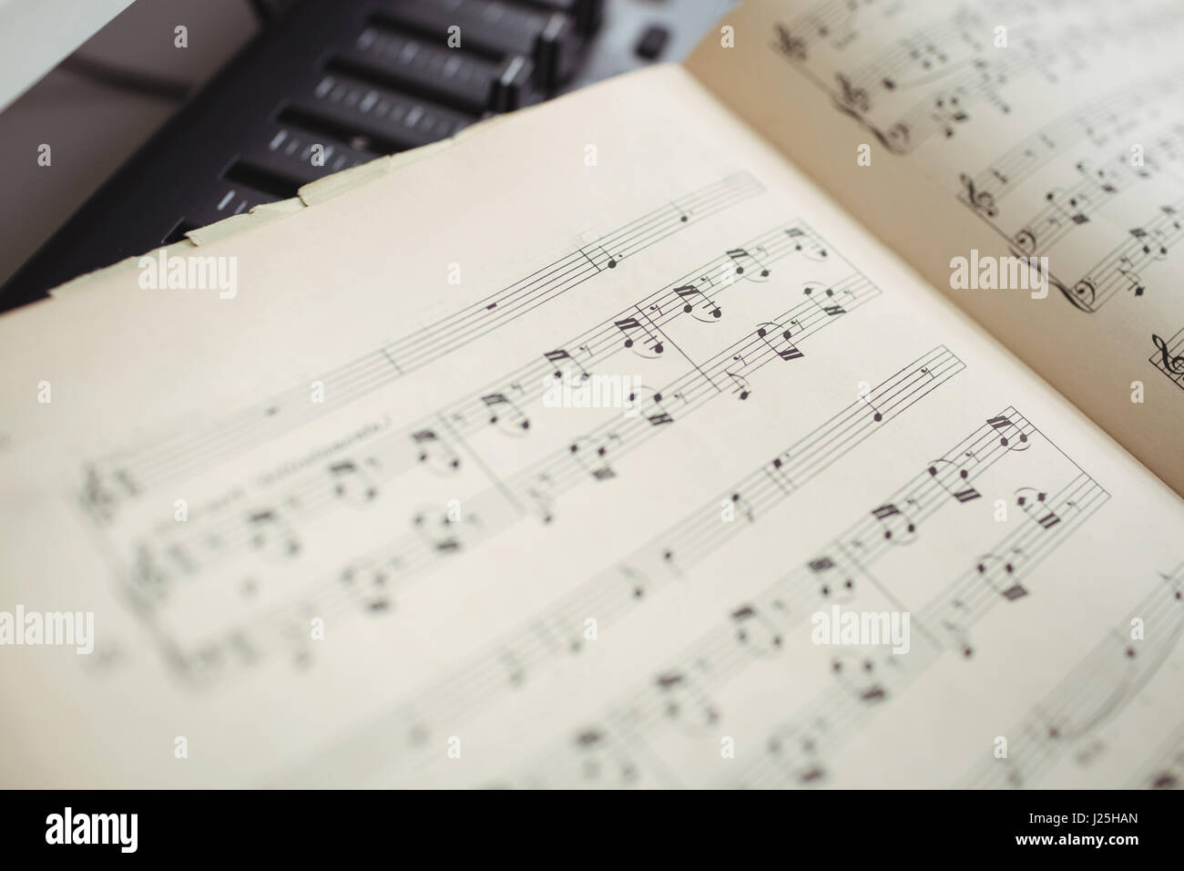 Close up of musical notes in studio - Stock Image