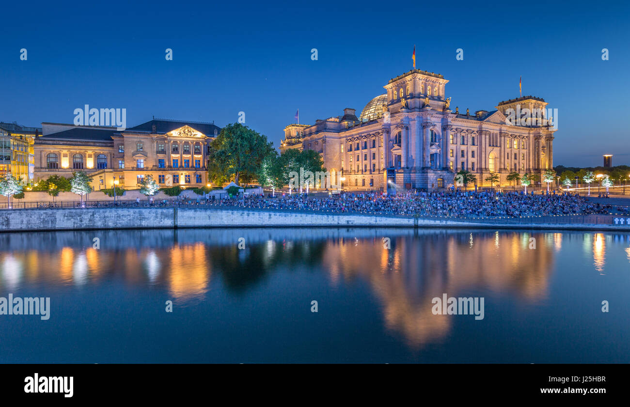 Panoramic view of modern Berlin government district with famous Reichstag building and Spree river illuminated in - Stock Image