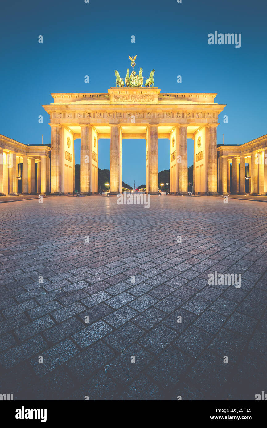 Classic vertical view of Brandenburg Gate, Germany's most famous landmark and a national symbol, in post sunset - Stock Image
