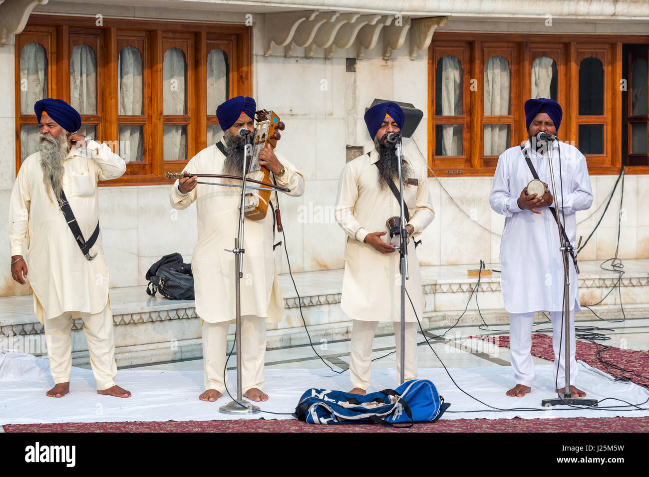 Religious songs being performed by a musical troupe inside the Golden Temple, Amritsar, Punjab, India - Stock Image