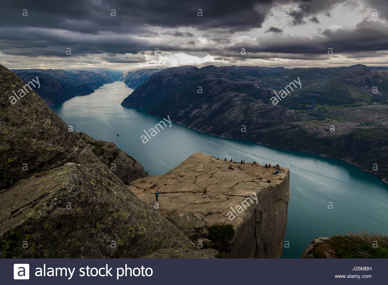 Preikestolen or Prekestolen (Preacher's Pulpit or Pulpit Rock)  is a famous tourist attraction in the municipality - Stock Image