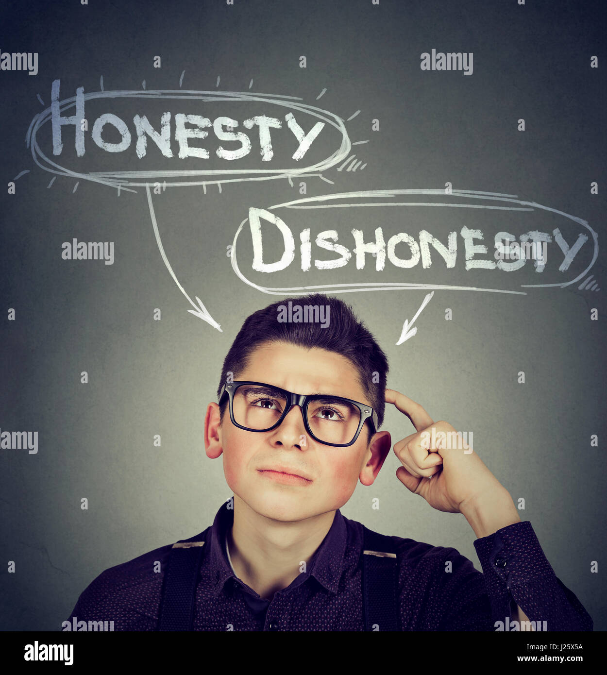 Young man making a decision honesty vs dishonesty - Stock Image