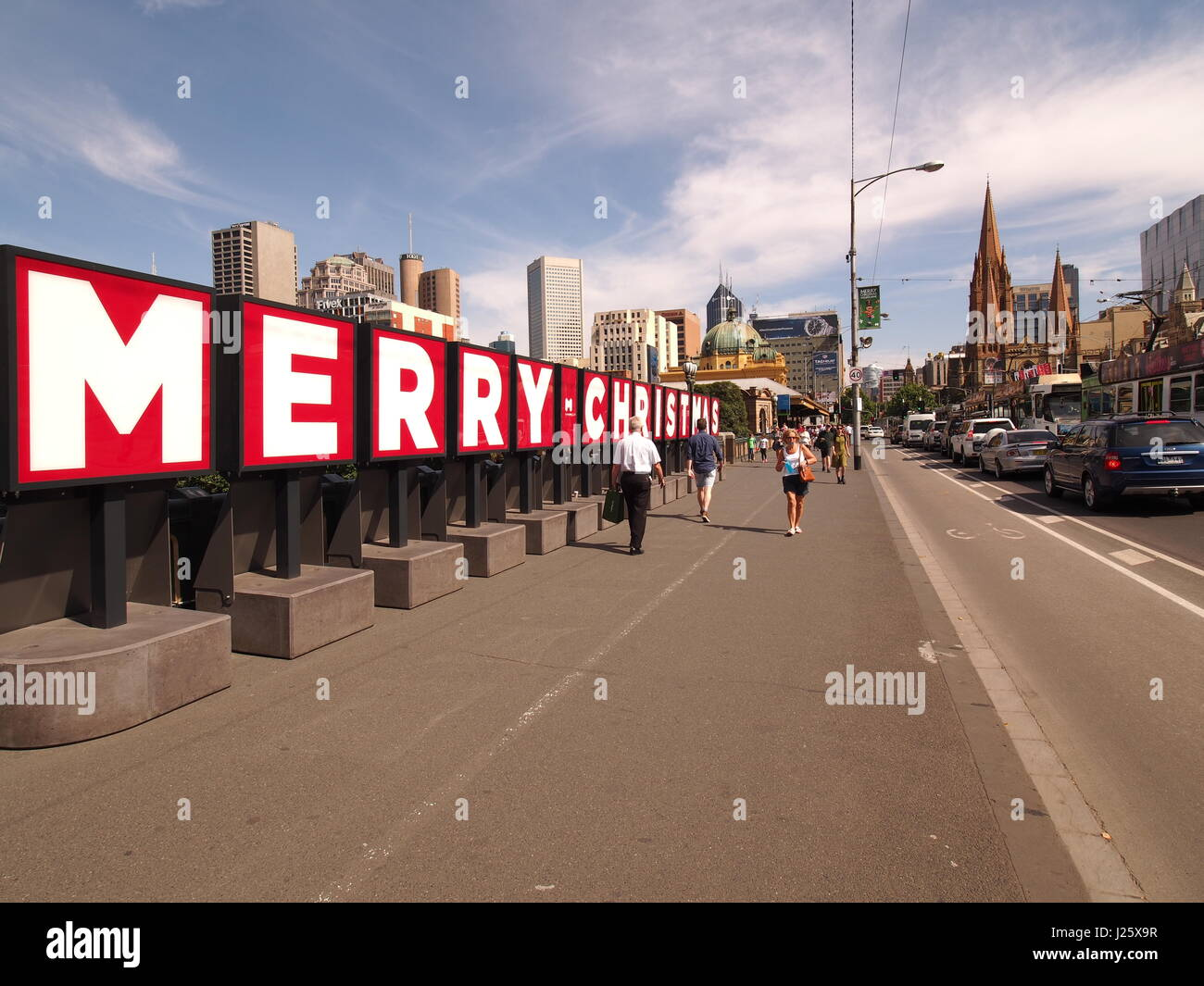 Melbourne, Australia - December 22 , 2015: Christmas wording in big letters on boards near Flinders Street Station - Stock Image