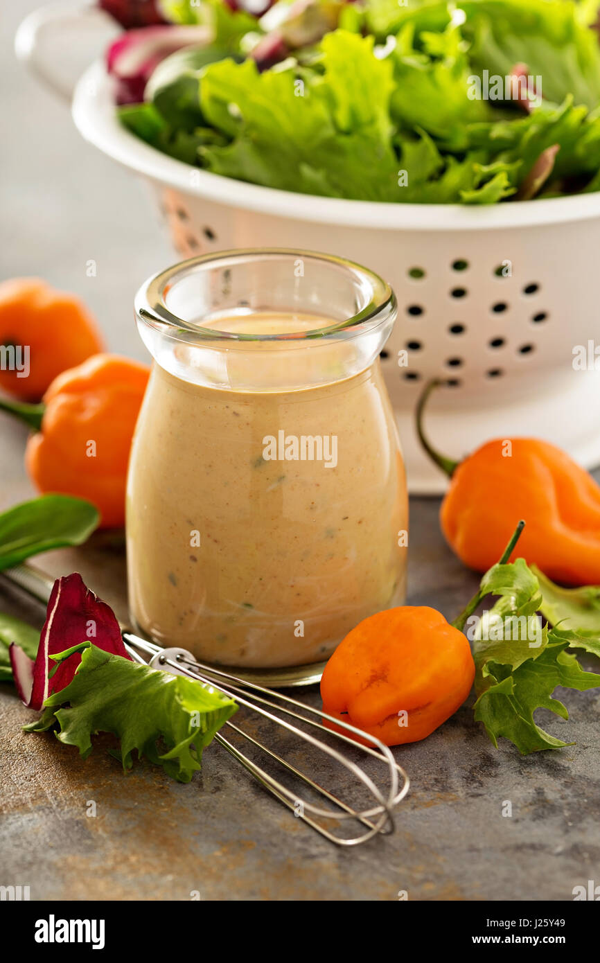 Homemade spicy ranch dressing with hot peppers Stock Photo