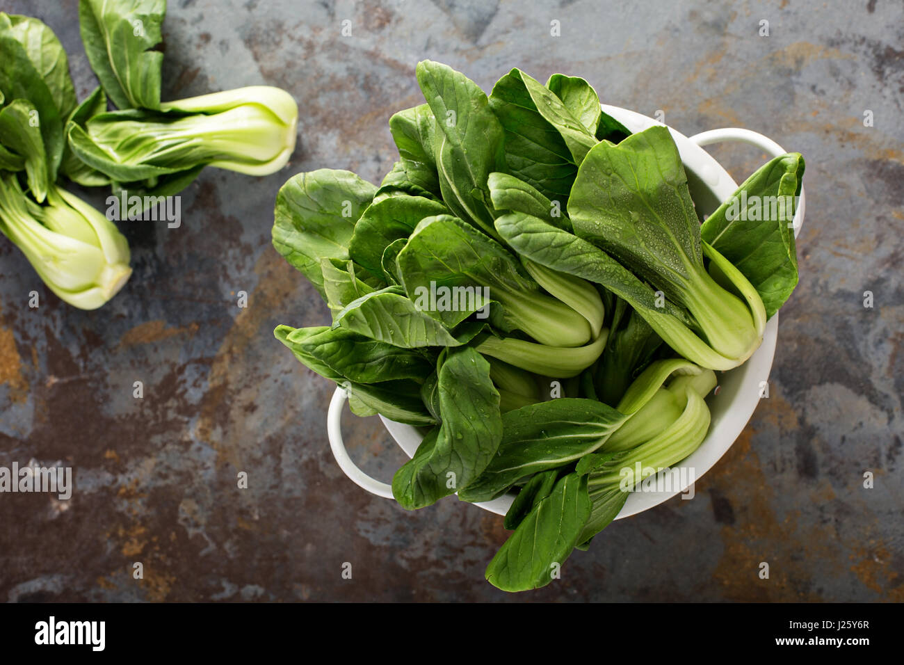 Fresh washed baby bok choy in a colander - Stock Image