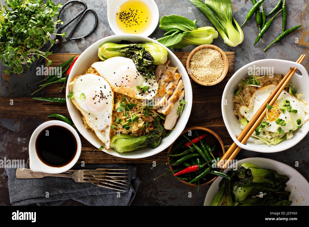 Asian food concept with fried rice, baby bok choy, eggs and soy sauce Stock Photo