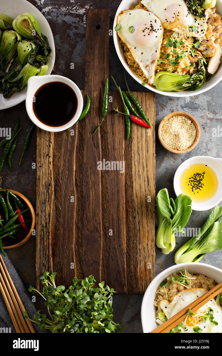 Rice snacks stock photos rice snacks stock images alamy asian food concept with fried rice baby bok choy eggs and soy sauce with ccuart Gallery