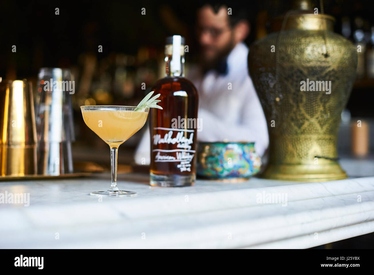Mixologist crafting cocktails at bar stella in Los Angeles, CA. - Stock Image