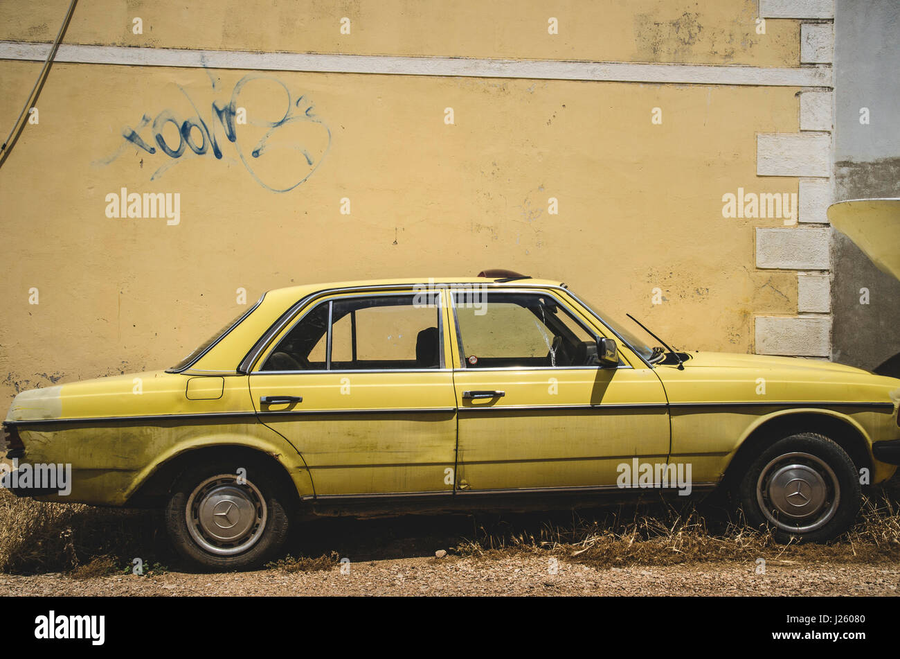Old Yellow Car Against Yellow Wall, Vis, Croatia Stock Photo ...