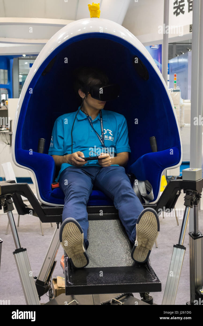 Groovy Asian Boy Playing Vr Game On Vr Chair Egg Stock Photo Caraccident5 Cool Chair Designs And Ideas Caraccident5Info