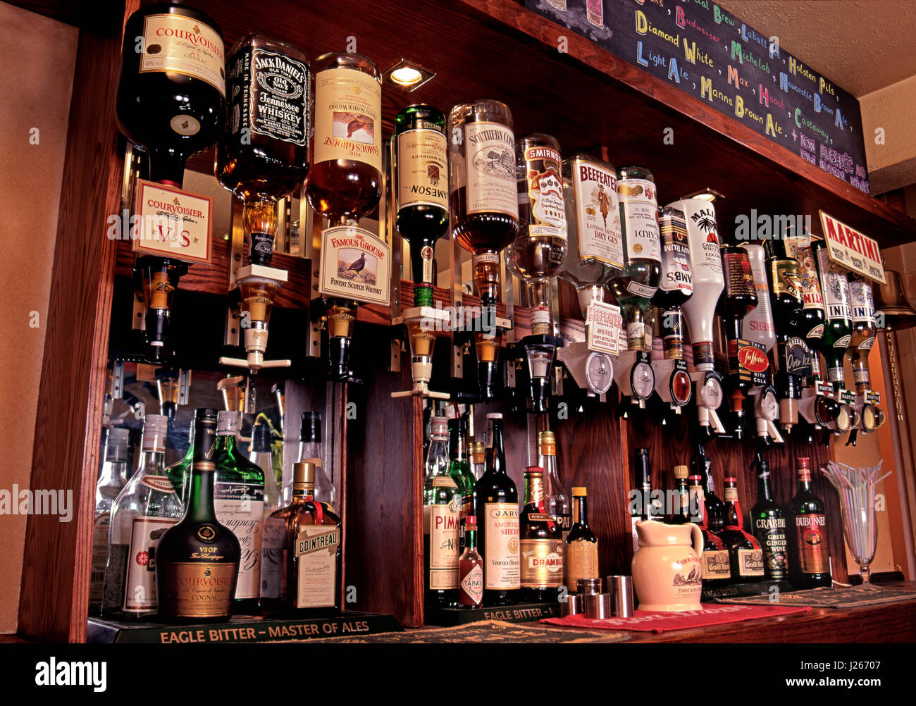 PUB SPIRITS OPTICS BAR view of variety of spirits, alcoholic drinks and optics on display for sale in a typical - Stock Image