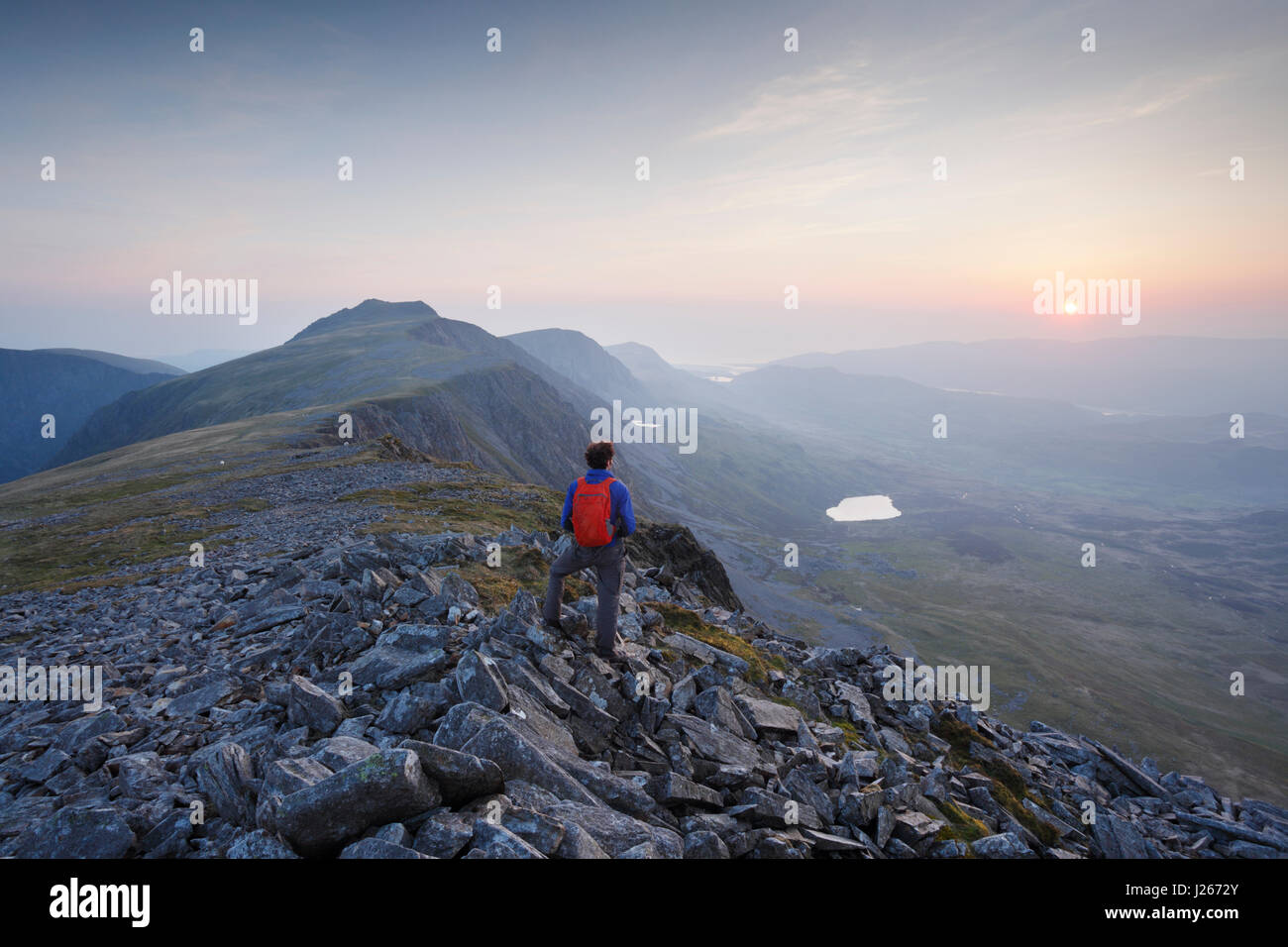 Hillwalker on Cadair Idris at sunset. Snowdonia National Park. Gwynedd. Wales. UK. - Stock Image