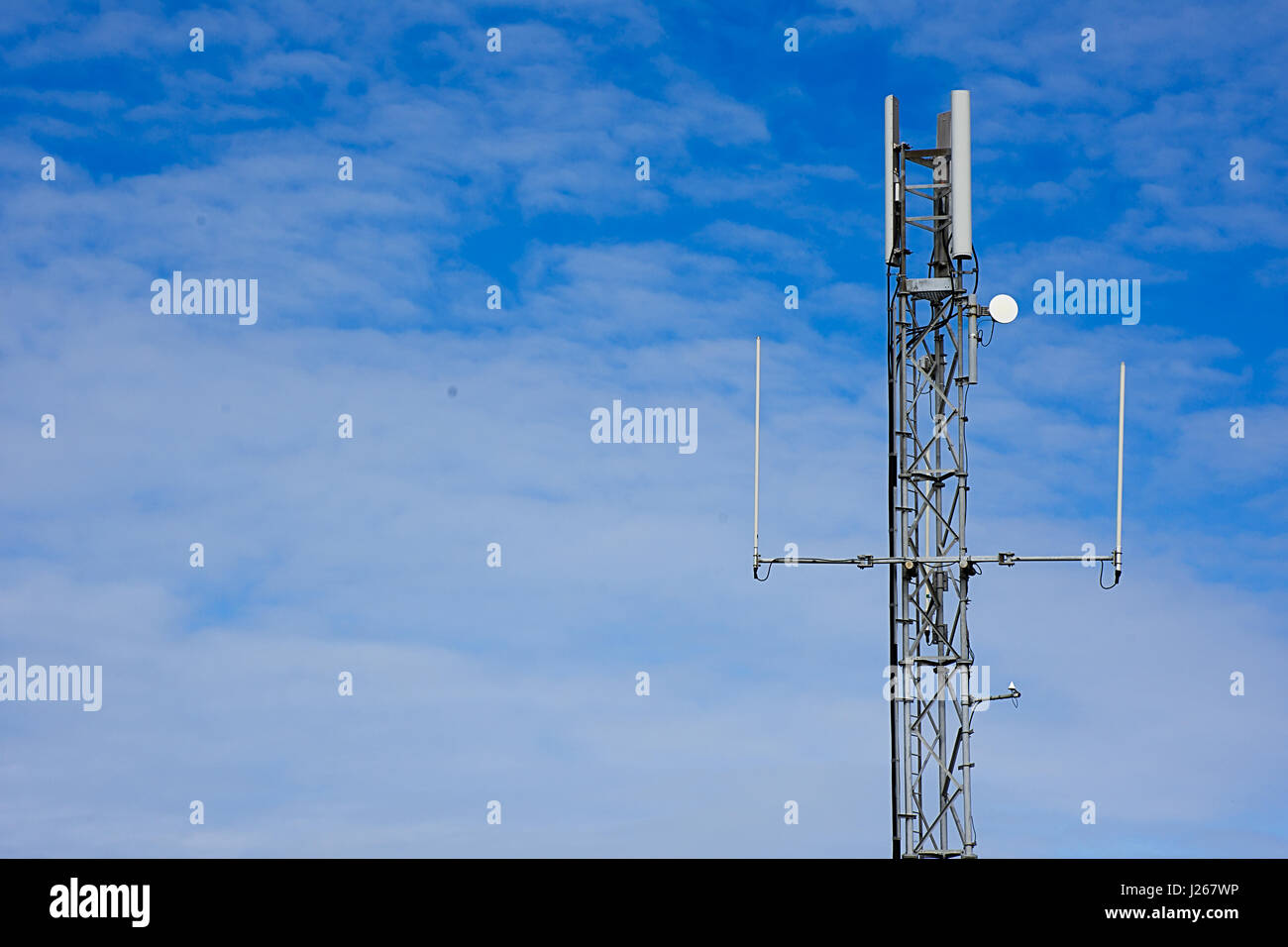 Mobile antenna station,North Wales,Uk.Space for edit or text,blue sky with clouds background.Connectivity Uk. - Stock Image