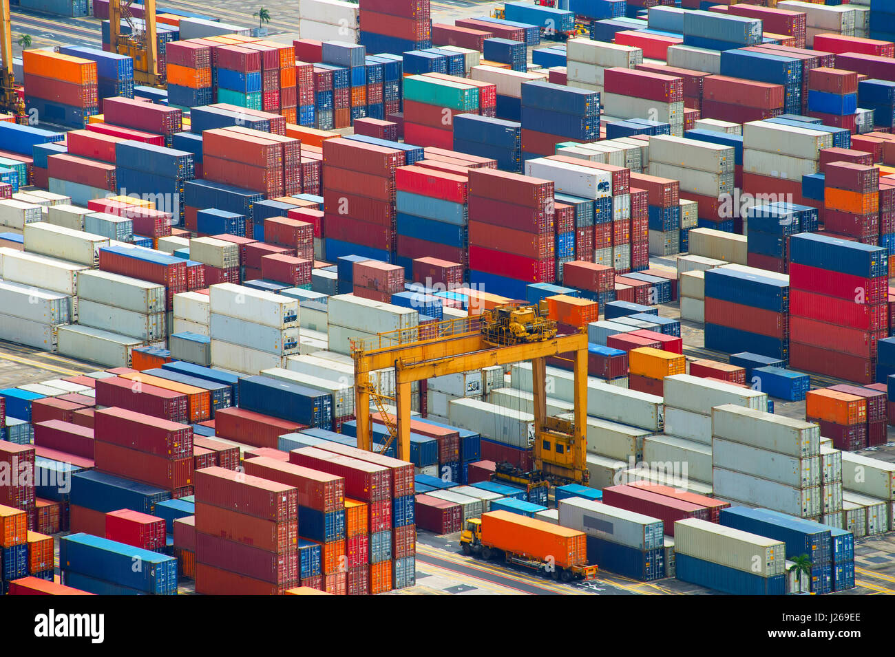 Lots of shipping containers at Singapore industrial port. Background Stock Photo