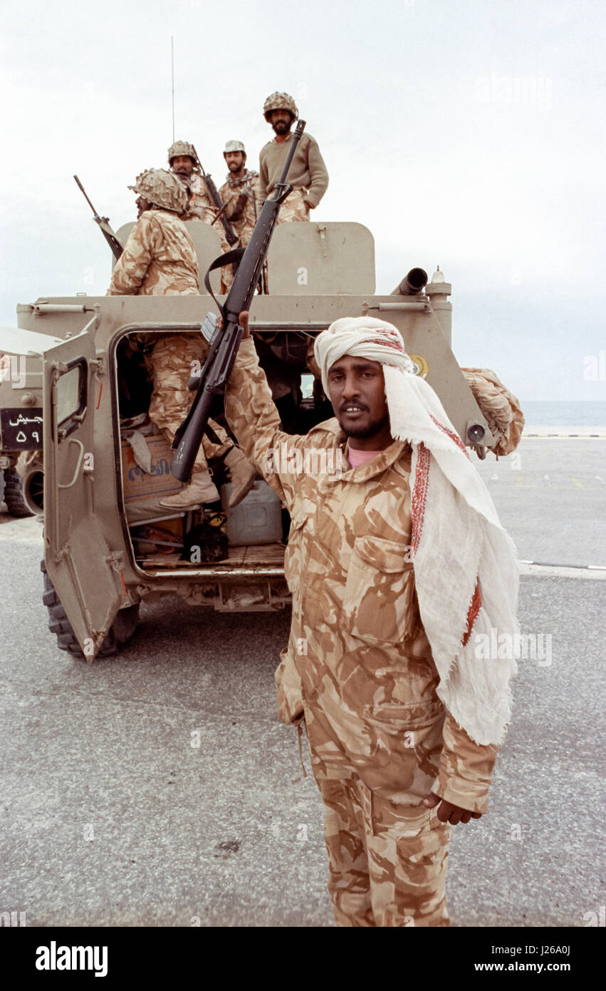 Saudi Arabian national guard soldiers celebrate after leading coalition forces in the recapture of the city following - Stock Image