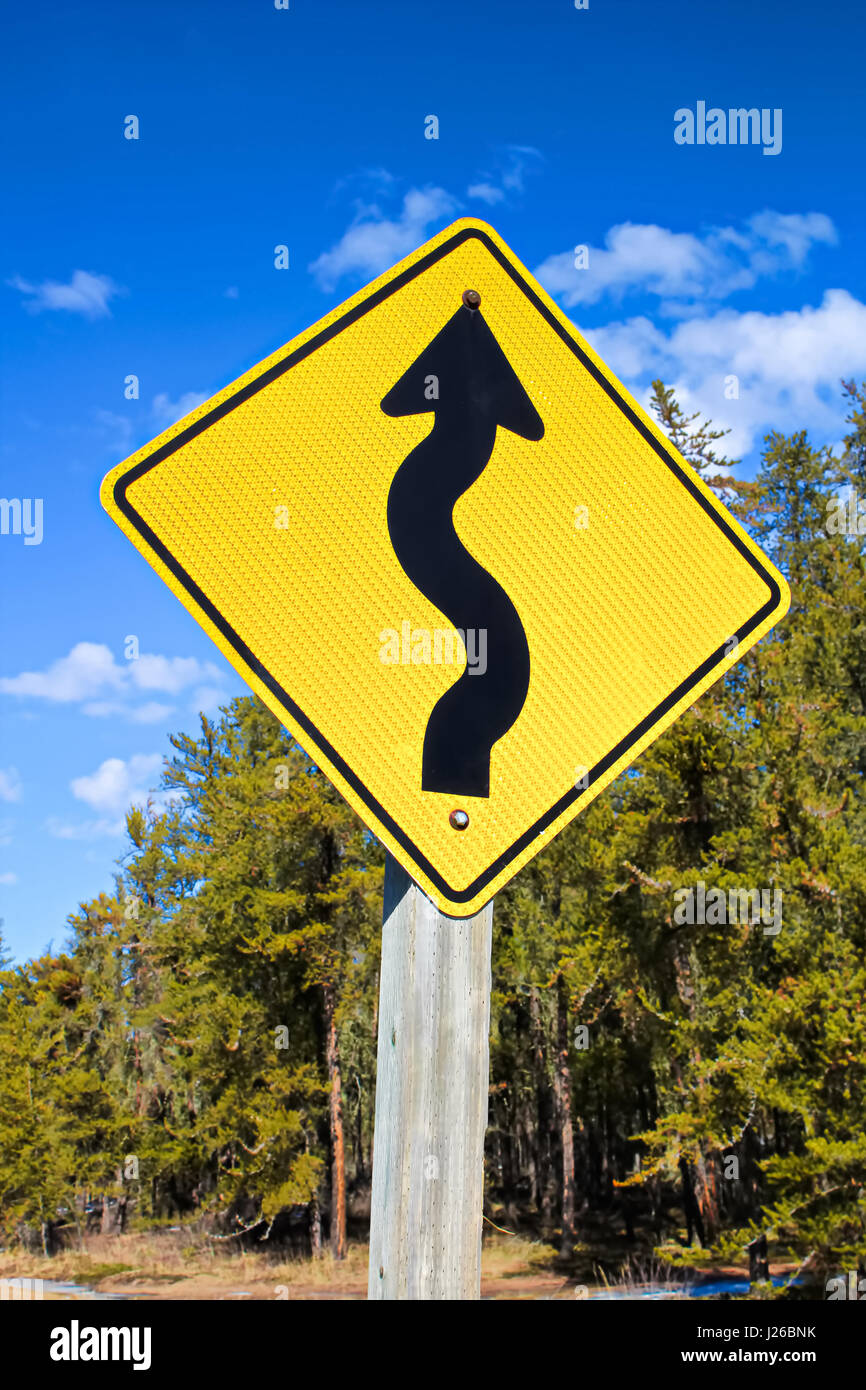Warning of curvy road ahead - Stock Image