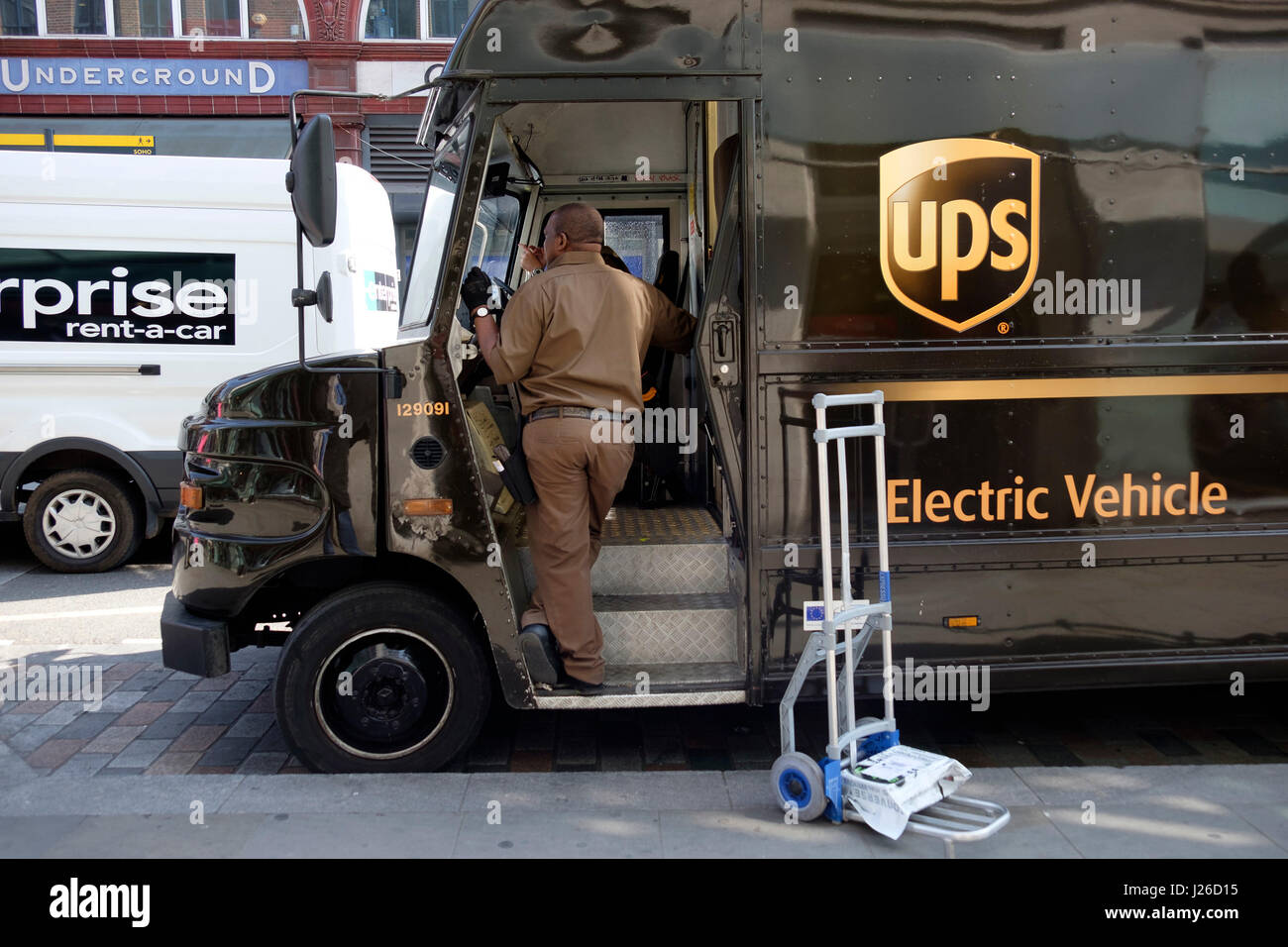 Brown UPS electric delivery vehicle Stock Photo: 139054193
