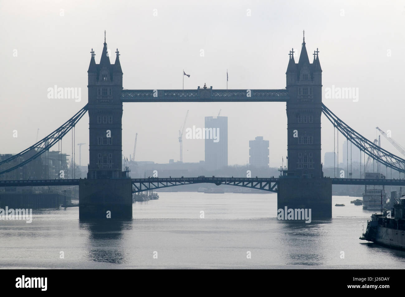 Silhouetted view of the Tower Bridge in London, England, United Kingdom, Europe - Stock Image