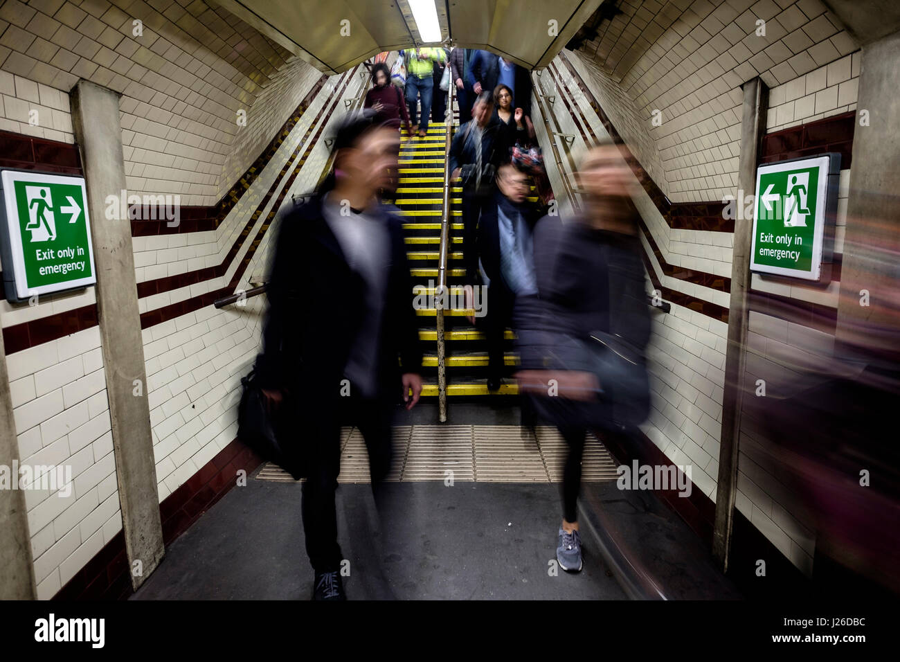 People walking fast during rush hour at an underground metro station in London, England, UK, Europe - Stock Image