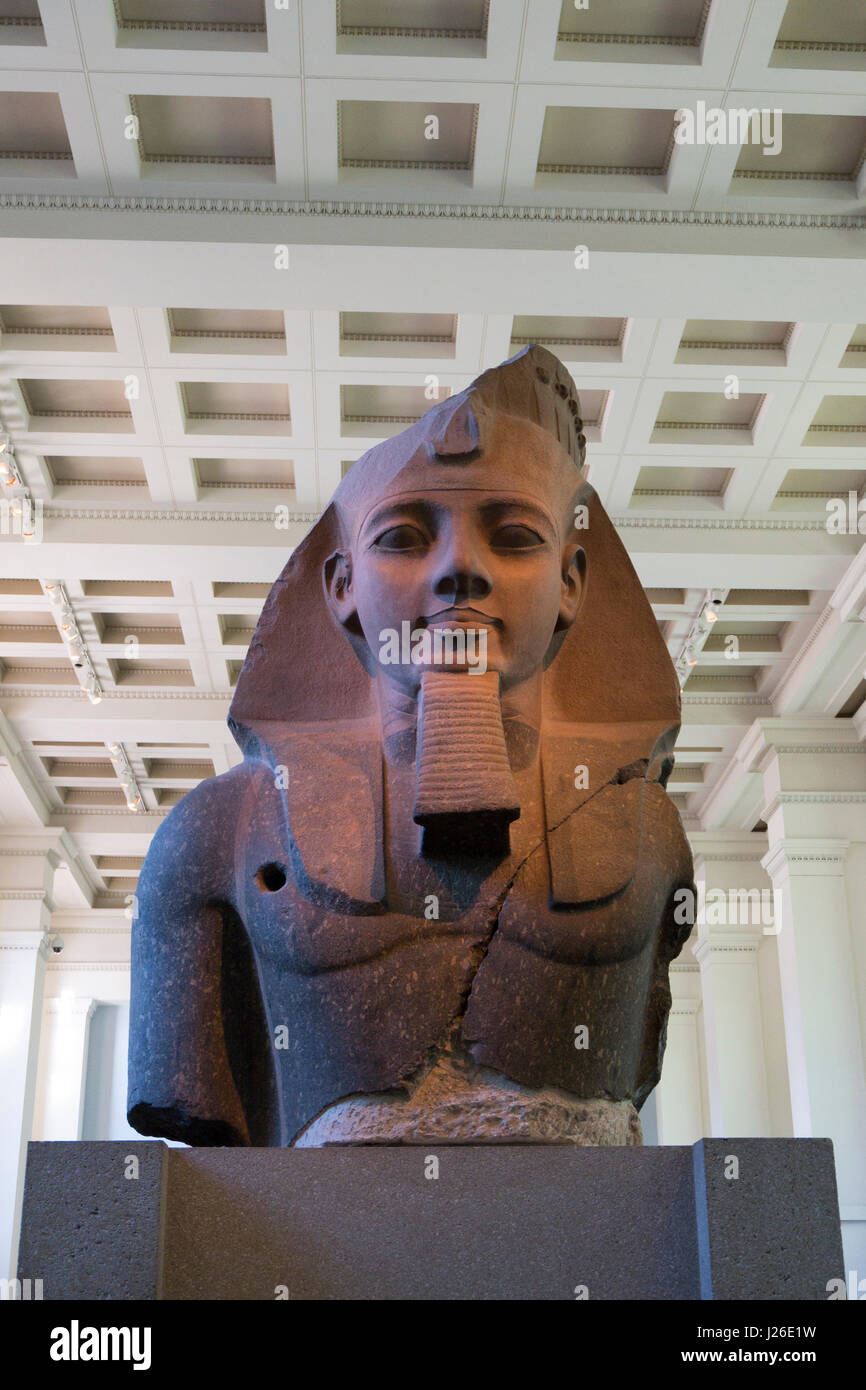The Younger Memnon egyptian statue of Pharaoh Ramesses II at The British Museum interior, London, England, United - Stock Image