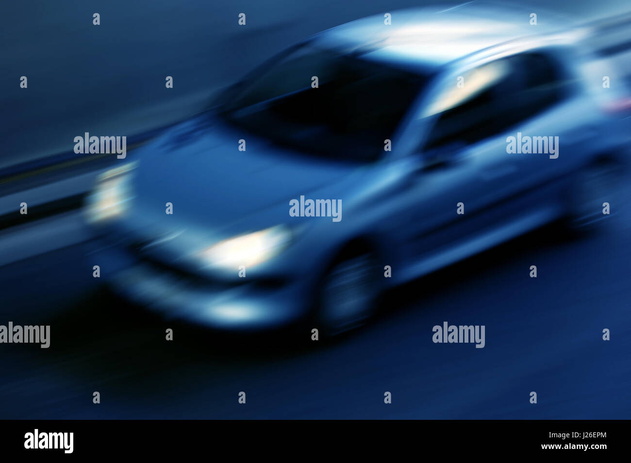 car under a city tunnel with motion blur effect - Stock Image