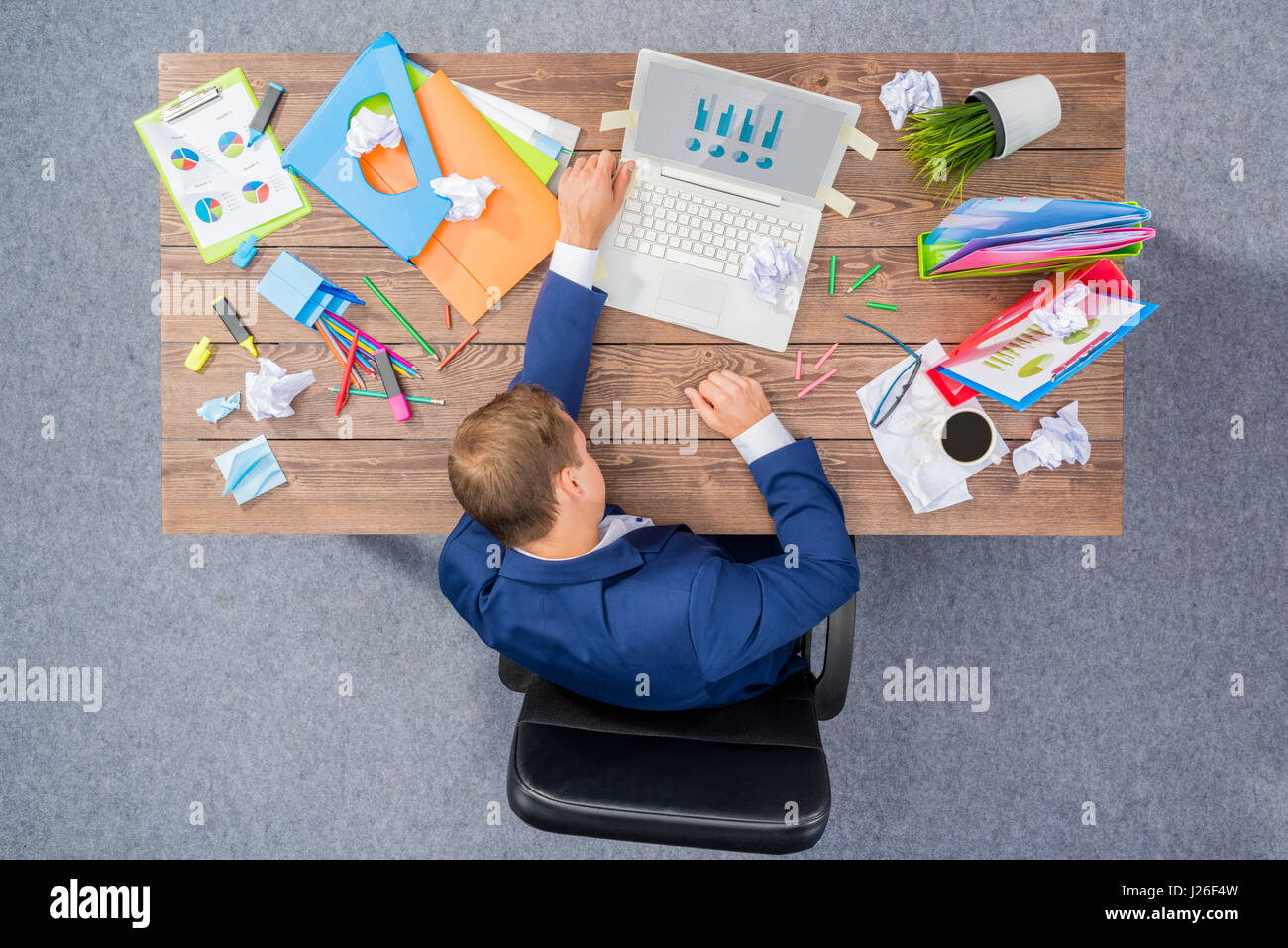 Overworked businessman - Stock Image